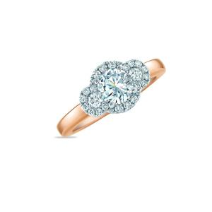 Diamond halo three-stone ring with polished shank.