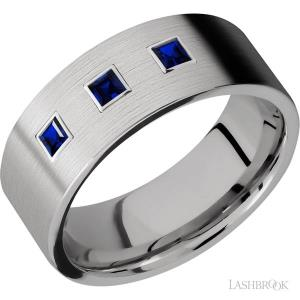 8 mm wide/Flat/Titanium band with an arrangement of 3, .1 carat Princess Sapphire stones in a Bezel setting.